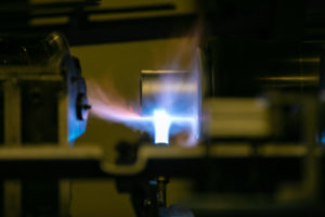 Heating up a tube for roller manufacturing.